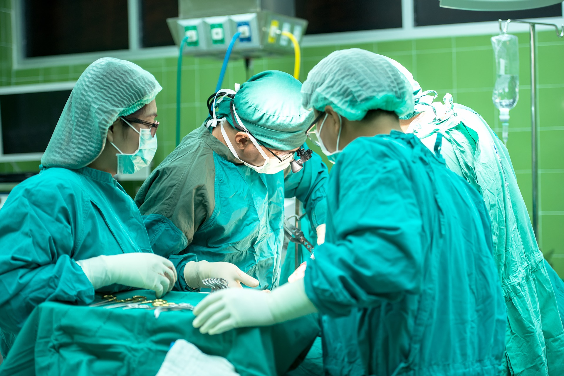 Surgeons perform an operation in a hospital