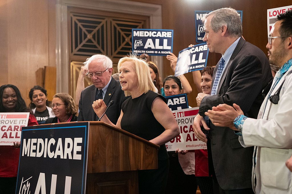 2020 Democratic candidate Sen. Bernie Sanders (I-VT) and former candidate Sen. Kirsten Gillibrand (D-NY) rally for Medicare for All in April 2019.